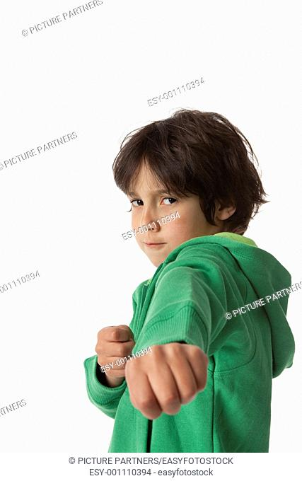 Little boy in fighting position on white background and negative space for text