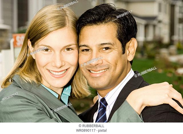 Portrait of a businessman and a businesswoman smiling