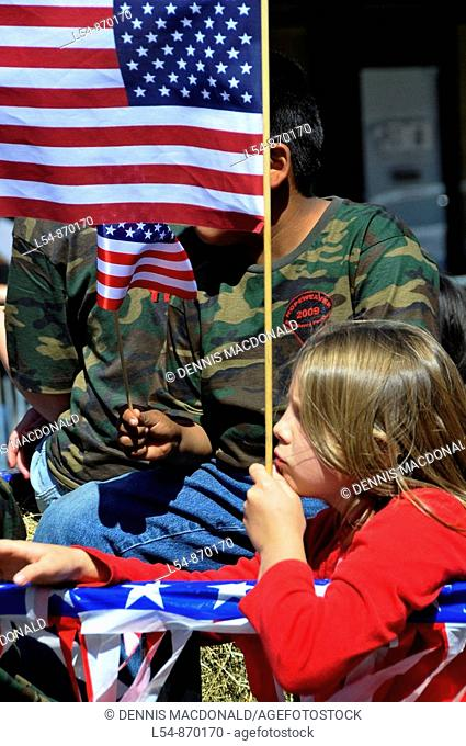 White girl with flag on Patriotic Float in Strawberry Festival Parade Plant City Florida