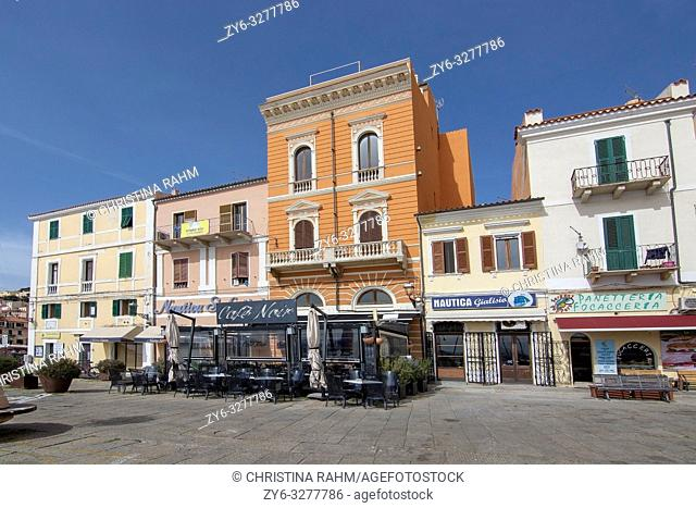 ISOLA MADDALENA, SARDINIA, ITALY - MARCH 7, 2019: Cafe Noir in the port area back streets on a sunny day on March 7, 2019 in La Maddalena, Sardinia, Italy