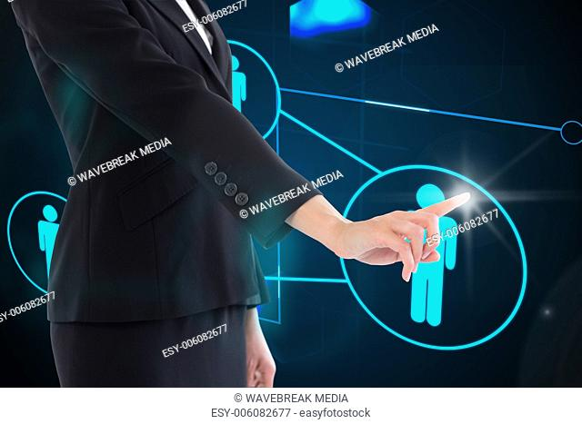 Composite image of businesswoman pointing on glowing futuristic blue background