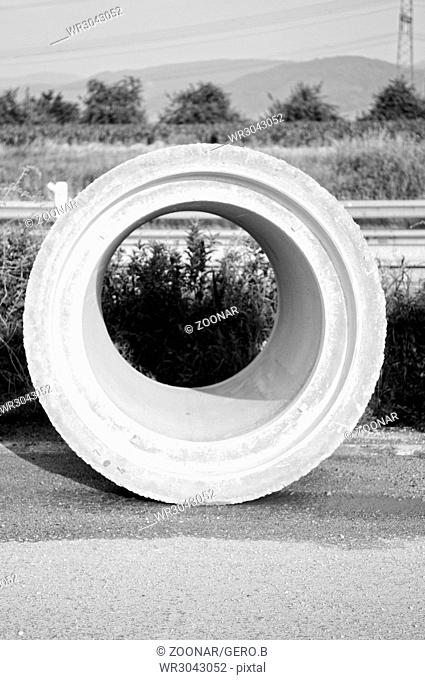 Concrete pipe at the construction site in black and white