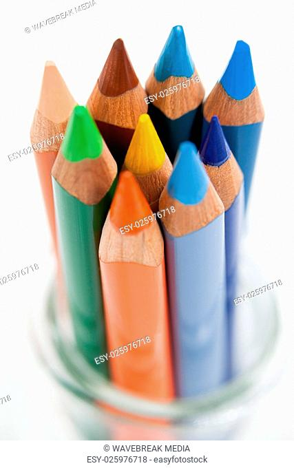 Close-up of colored pencils kept in a glass jar