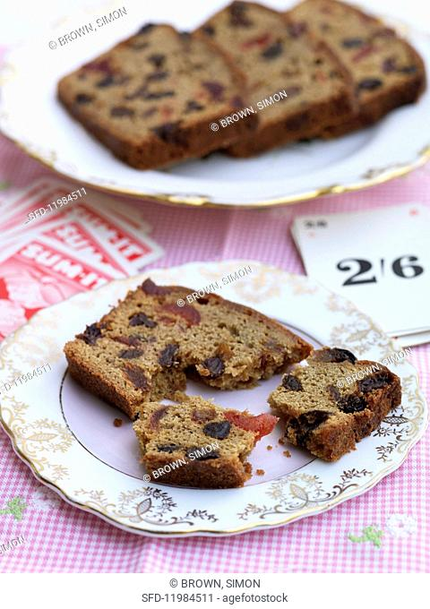 Slices of cinnamon loaf cake with dried fruit