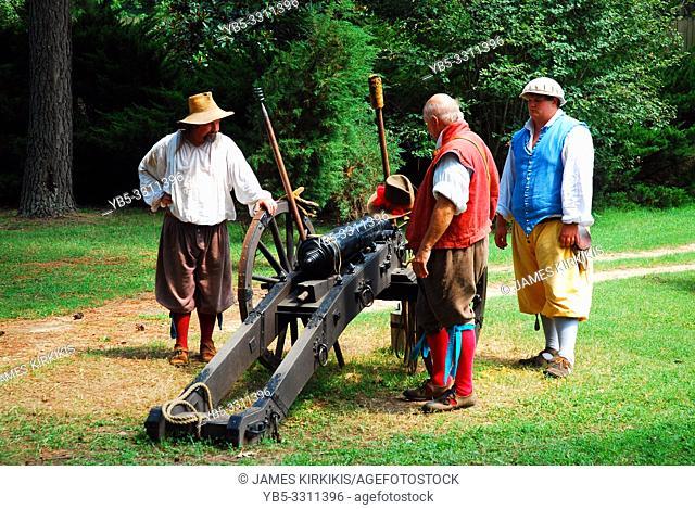 Reenactors demonstrate the firing of a colonial cannon in Jamestown, Virginia
