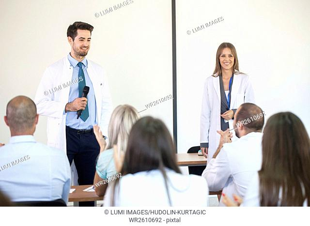Instructors teaching healthcare workers in training class