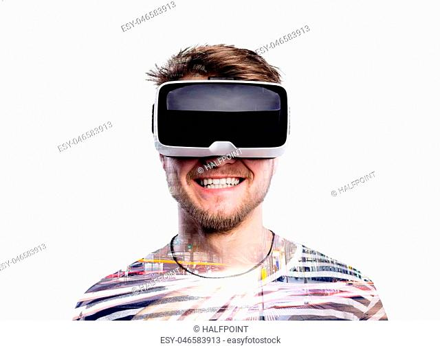 Double exposure. Hipster man in striped black and white sweatshirt wearing virtual reality goggles. Night city. Illuminated