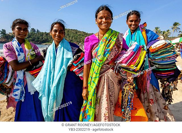 Women Selling Fabrics On Baga Beach, Goa, India