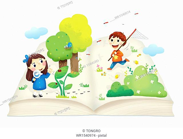 a boy and a girl playing on an open book