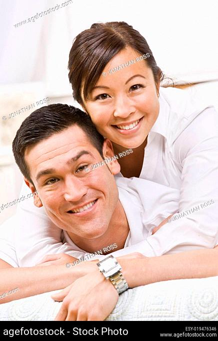 Attractive Couple Hugging and Smiling at the Camera