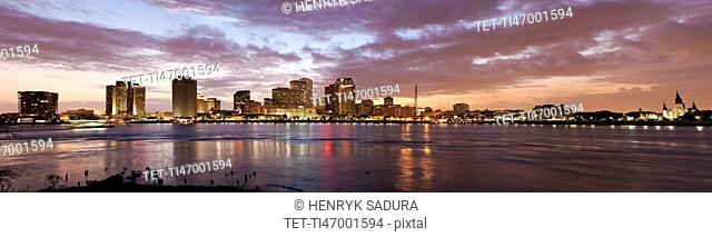 Louisiana, New Orleans, Mississippi river and city skyline with skyscrapers at sunset