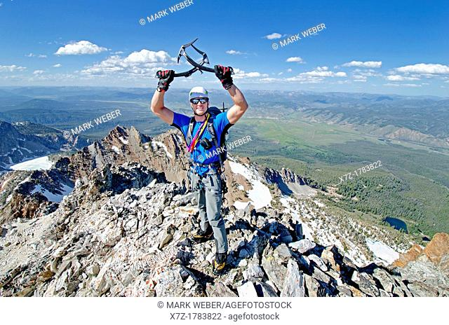 On the summit after climbing The June Couloir on the North Face of Williams Peak high above the Sawtooth Valley in the Sawtooth Mountains near the town of...