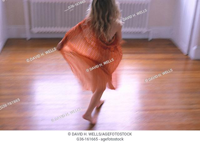 Girls plays/dances in home
