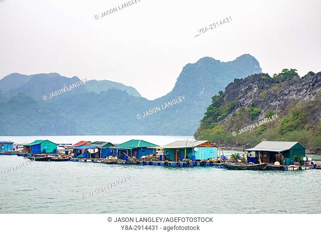 Floating village in Ha Long Bay near Cat Ba Island, Hai Phong Province, Vietnam