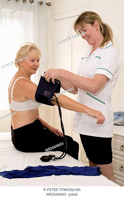 Nurse checking a patient's blood pressure