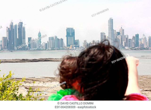 Mother shows her daughter a beautiful view over the city