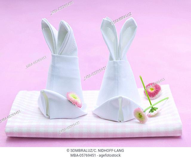 napkins folded like rabbits with flower heads
