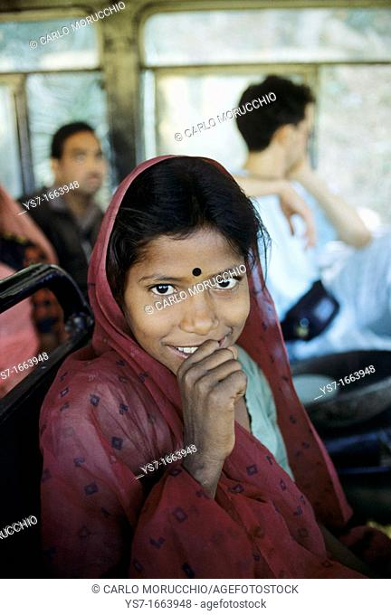 Young girl traveling on a bus in Rajasthan state, India, Asia