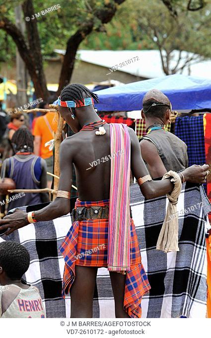 Young Banna cloths choosing in Dimeka market. Omo valley National Park, Southern Ethiopia