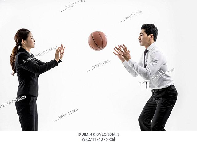 Business people playing basketball