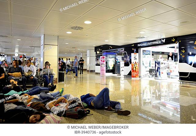 Overcrowded waiting area, gates, tired passengers, duty-free zone, Madrid Barajas Airport, Madrid, Spain