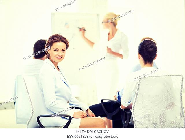 picture of smiling businesswoman on business meeting in office