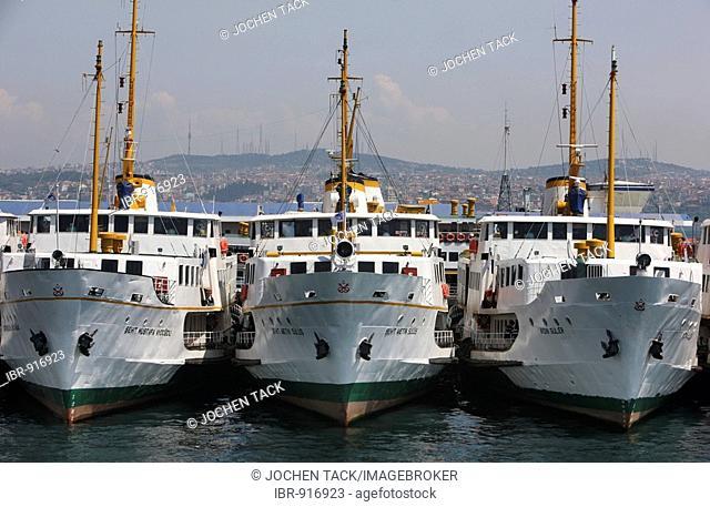 Ferry boats on the Bosporus strait, wharves on Galata bank, Istanbul, Turkey