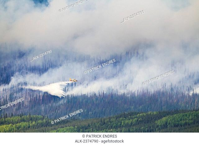 A duck aircraft, otherwise known as a super scooper, dumps water to suppress the Hastings wildland forest fire near Murphy Dome, North of Fairbanks; Alaska