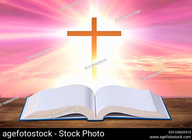 Religious concept with the cross and bible book