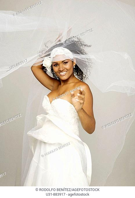 Black Latin Bride in her 20s discovers herself from under her veil