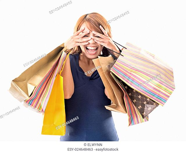 Cheerful shopping woman of Asian holding bags on white studio background
