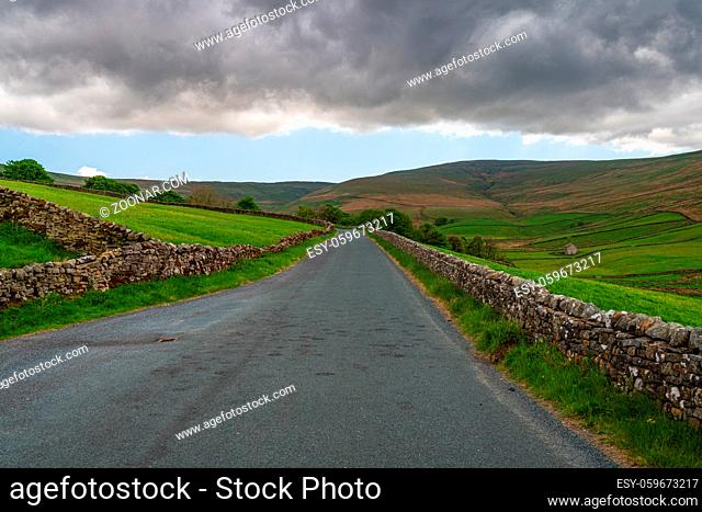 Rural road in the Upper Wensleydale near Gayle, North Yorkshire, England, UK