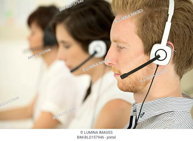 Close up of business people wearing headsets
