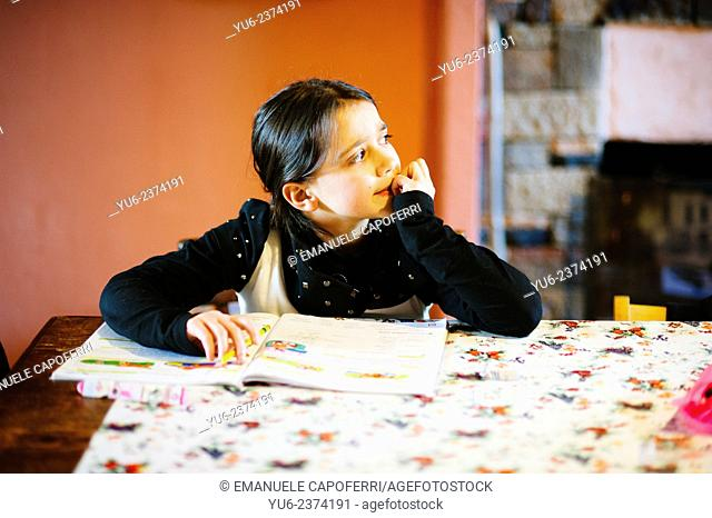 Child plays homework