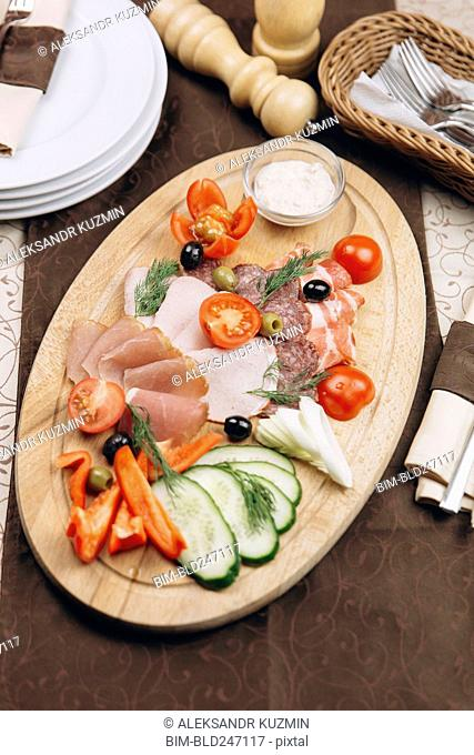 Appetizers with sauce on table