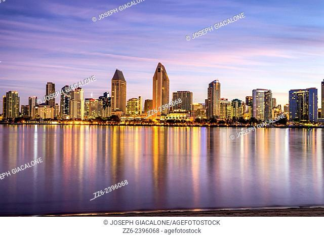 The San Diego Downtown Skyline reflecting off of the water during sunrise. San Diego, California, United States