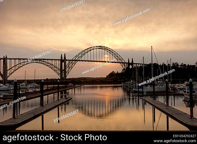 Yaquina bay bridge at sunset from the marina on the south side in Newport, Oregon