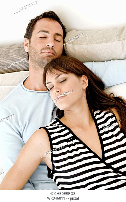 High angle view of a young couple sleeping together