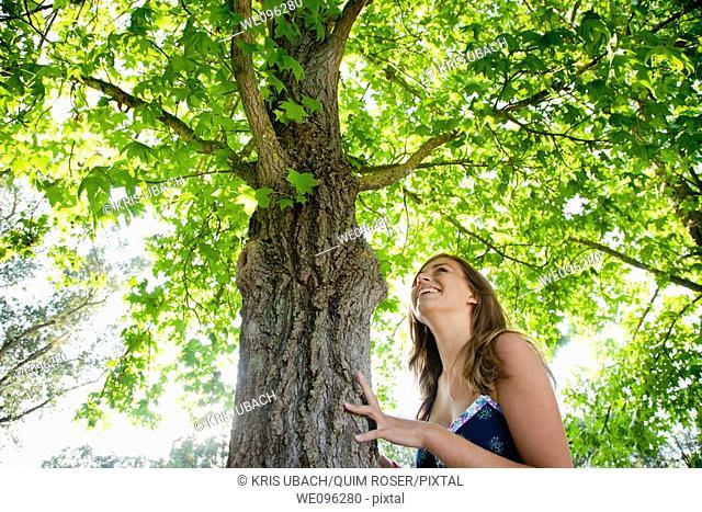 Girl hugging a tree