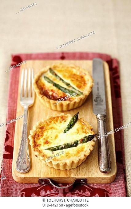 Two asparagus and parmesan tarts