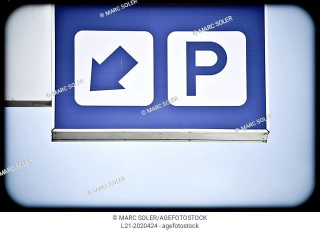 Traffic sign indicating the way to a parking place