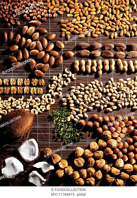 Assorted nuts on a brown raffia mat