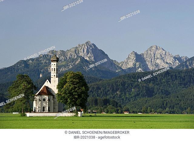 Church of St Coloman, Tannheim Mountains at the back, near Fuessen, Allgaeu region, Bavaria, Germany, Europe