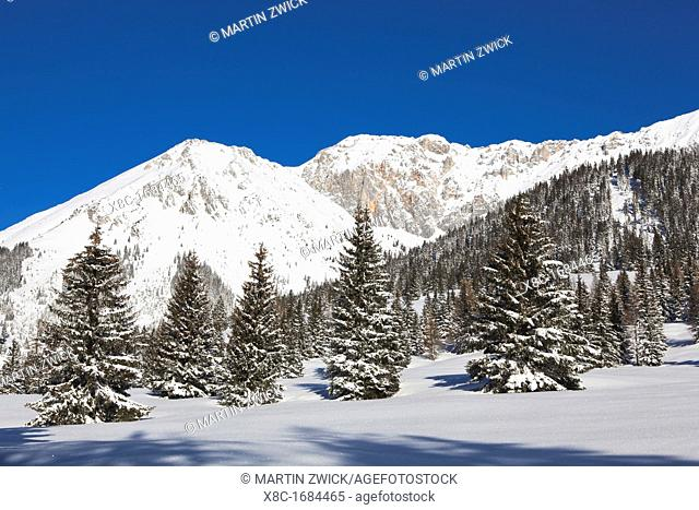 Valley Gaistal with snow during deep winter in Tyrol, Austria View towards the mountain crest of the Wetterstein Mountain range with the peak of Kleiner Wanner...