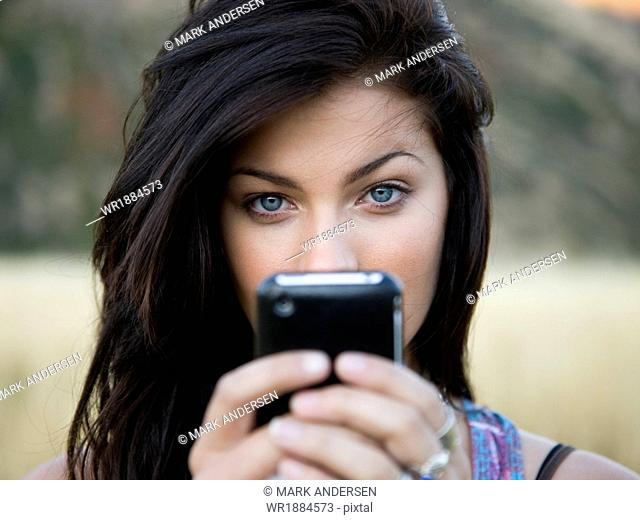 USA, Utah, South Fork, Portrait of teenage girl (16-17) holding mobile phone
