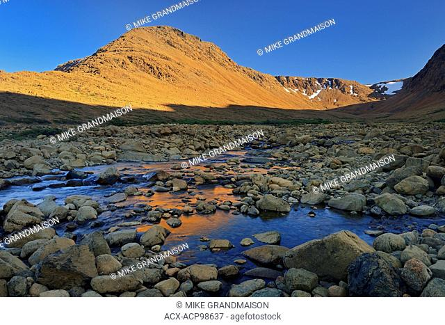 Last light on the Tablelands (Earth's mantle) made up of Peridotite which is high in iron Gros Morne National Park Newfoundland & Labrador Canada