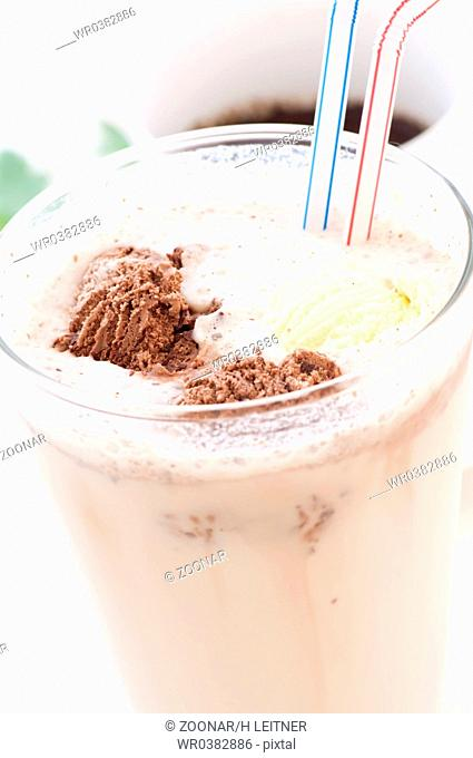 Milkshake with vanilla and chocolate as closeup in a glass