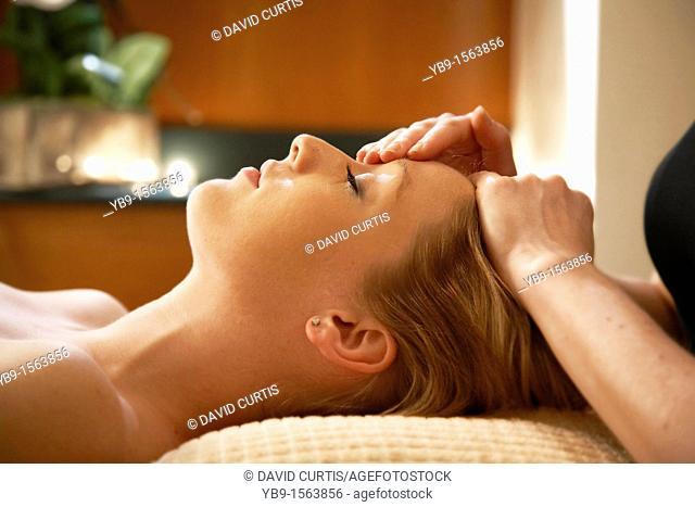 Young Woman having a Facial massage