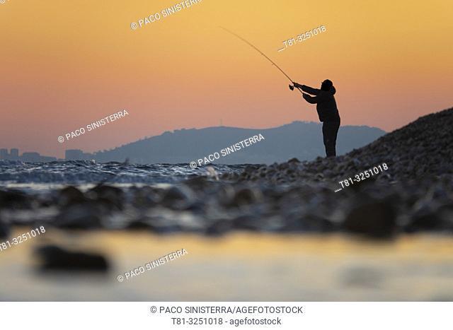 Fisherman fishing on the beach, Alcocebre Castellon, Spain