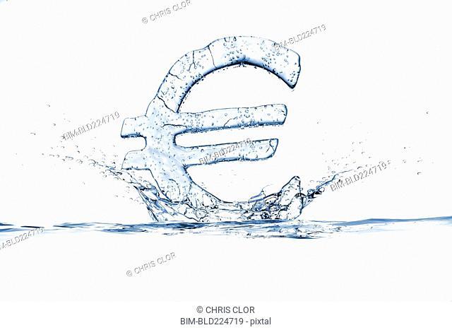 Water droplets splashing from ice euro symbol